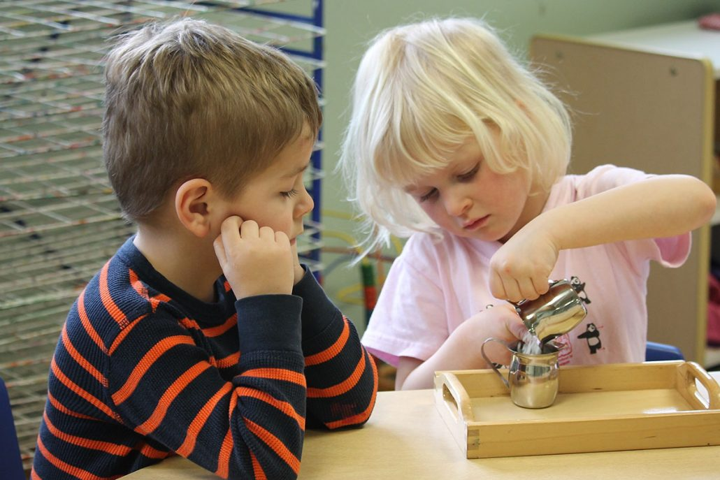 boy and girl learning math with a creative project