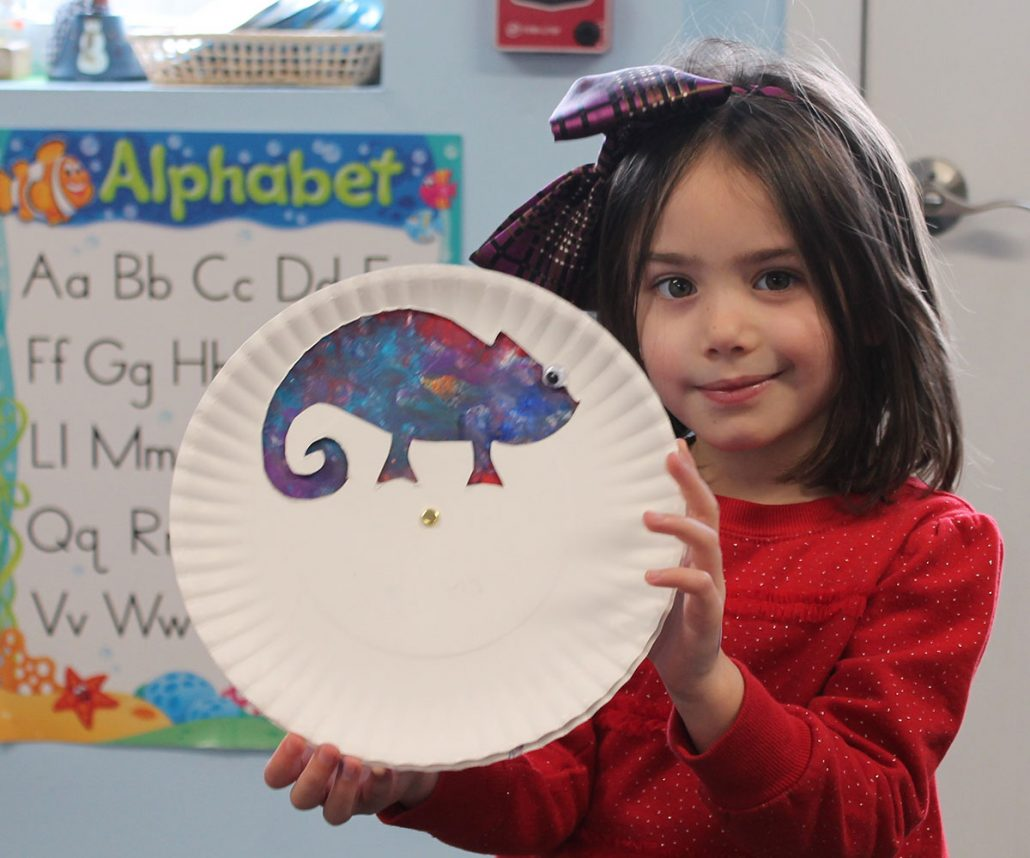 student with chamelon plate